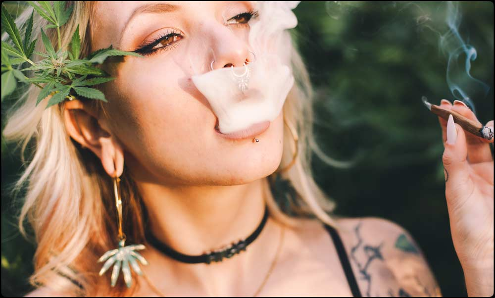 Girl With Red Eyes Smoking a Blunt