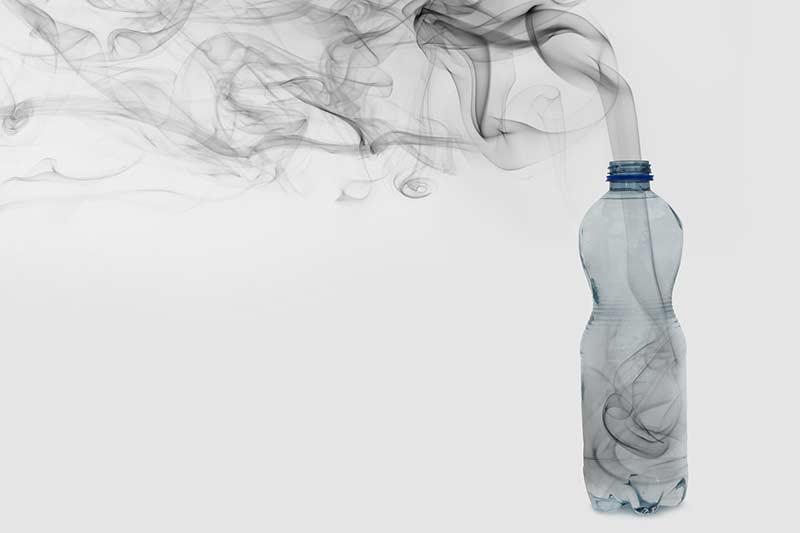 Plastic bottle with smoke